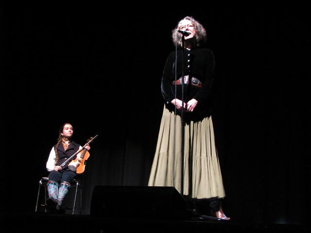 Fiddler Brigid Reedy listens to storyteller Teresa Jordan at The Moth Mainstage at the National Cowboy Poetry Gathering at Elko Nev. Feb. 4, 2017.  (F. Andrew Taylor/Las Vegas Review-Journal)