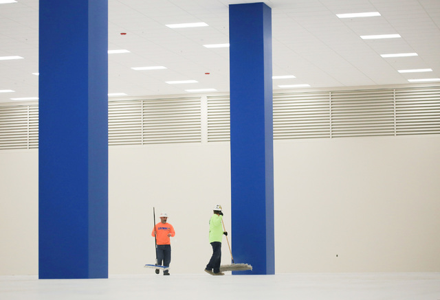 Marco Flores, 41, left, and Jorge Sanchez, 41, clean the floor of a server room expansion, built by Better Building Systems, at the ViaWest Lone Mountain Data Center on Friday, Feb. 24, 2017, in L ...