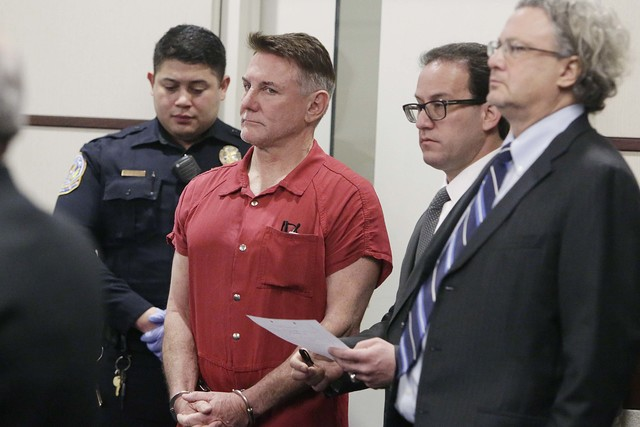 """Psychologist Gregory """"Brent"""" Dennis, second from left, appears with his attorneys Richard Schonfeld, second from right, and David Chesnoff during his first court appearance in Henderson Justice Co ..."""