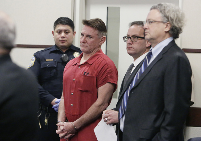 """Psychologist Gregory """"Brent"""" Dennis, second from left, appears with his attorneys Richard Schonfeld, second from right, and David Chesnoff during his first court appearance at Henderson Justice Co ..."""