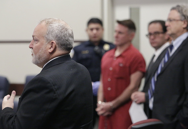 """Prosecutor Marc DiGiacomo addresses the court as Gregory """"Brent"""" Dennis, center, and his attorneys Richard Schonfeld, second from right, and David Chesnoff look on during Dennis' first court appea ..."""