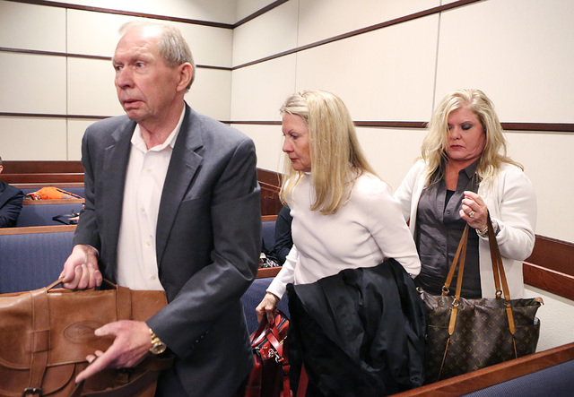 """Danny and Avis Winters, center, the parents of Susan Winters, and her sister-in-law Julie leave Henderson Justice Court, where psychologist Gregory """"Brent"""" Dennis made his first court appearance o ..."""