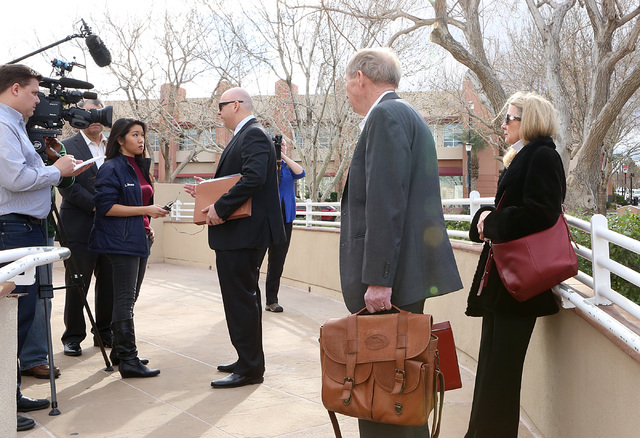 """Danny and Avis Winters, right, the parents of Susan Winters, watch as attorney Anthony Sgro addresses the media outside Henderson Justice Court, where psychologist Gregory """"Brent"""" Dennis made his  ..."""