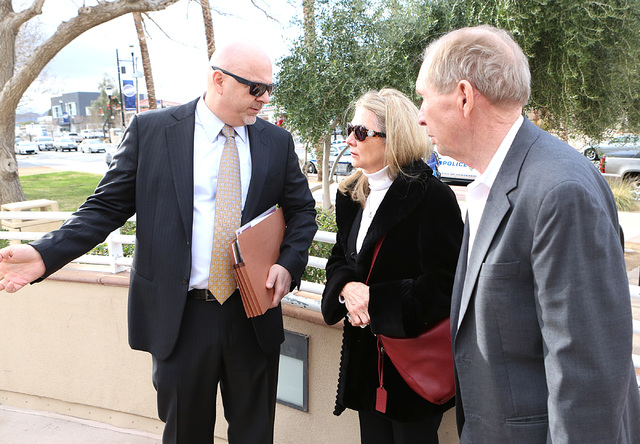 """Danny and Avis Winters, right, the parents of Susan Winters, talk with their family attorney Anthony Sgro outside Henderson Justice Court, where psychologist Gregory """"Brent"""" Dennis made his first  ..."""