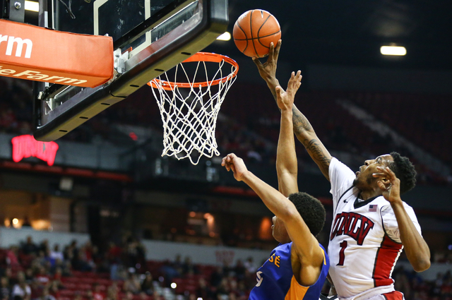 UNLV forward Derrick Jones Jr. (1) attempts to tip in a shot against San Jose State guard Brandon Clarke (15) on Feb. 10, 2016, at the Thomas & Mack Center. The American College Test has cance ...