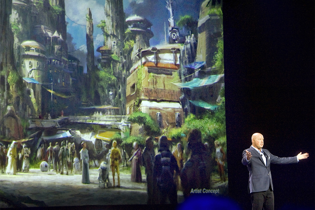 Bob Chapek, chairman of Walt Disney Parks and Resorts, speaks in front of concept art of the newly announced Star Wars Land, Aug. 15, 2015. Disney CEO Bob Iger said Tuesday, Feb. 7, 2017, the comp ...