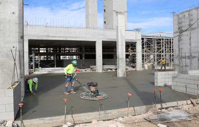 A worker smooths concrete with a power trowel at the under-construction Fremont 9 residential development site on 901 Fremont St. on Wednesday, Feb 8, 2017, in Las Vegas. ( Bizuayehu Tesfaye/Las V ...