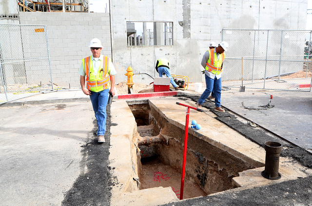 Guy Laing, left, project superintendent at Korte Construction, inspects fire hydrant supply line at the under-construction Fremont 9 residential development site on 901 Fremont St. on Wednesday, F ...