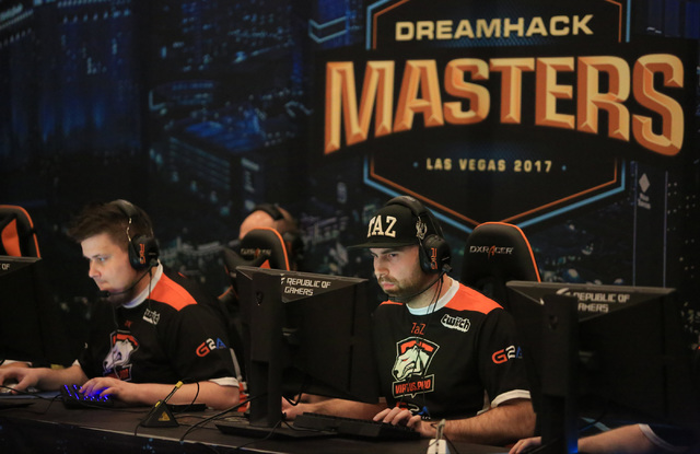 "Wiktor ""TaZ"" Wojtas, right, and Janusz ""Snax"" Pogorzelski, of Virtus.pro play Fnatic during the group stage of DreamHack Masters Las Vegas at the MGM Grand hotel-casino in Las Vegas on Friday, Feb ..."