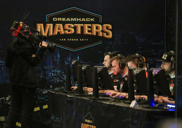 A cameraperson films Polish team Virtus.pro as the play Fnatic during the group stage of DreamHack Masters Las Vegas at the MGM Grand hotel-casino in Las Vegas on Friday, Feb. 17, 2017. The playof ...