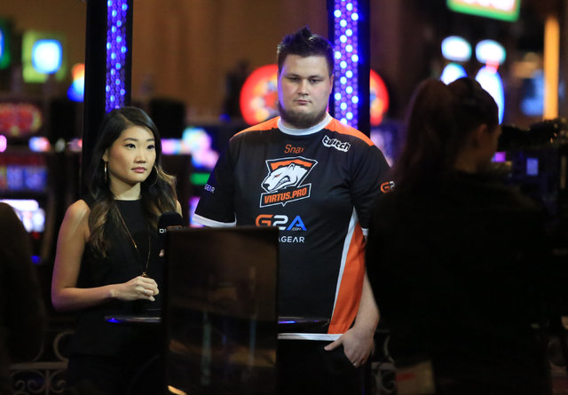 "Janusz ""Snax"" Pogorzelski, of Virtus.pro, center, films in interview after beating Fnatic in a best of three match during the group stage of DreamHack Masters Las Vegas at the MGM Grand hotel-casi ..."