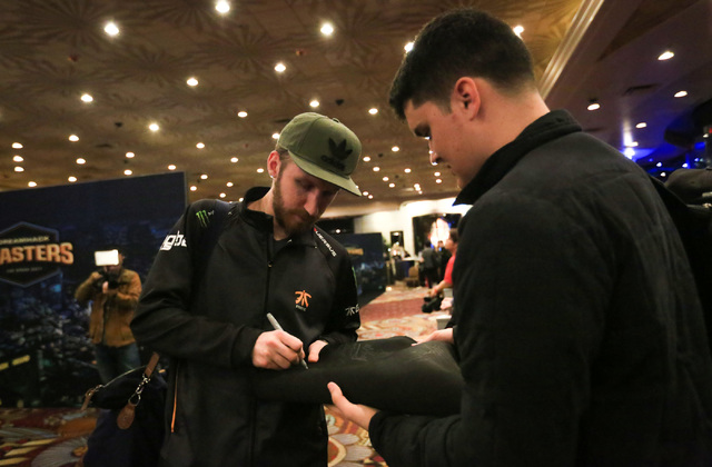 "Olof ""olofmeister"" Kajbjer, of Swedish team Fnatic, signs 26-year-old Phoenix resident Zach Willman's mousepad after being knocked out of the group stage of DreamHack Masters Las Vegas at the MGM  ..."