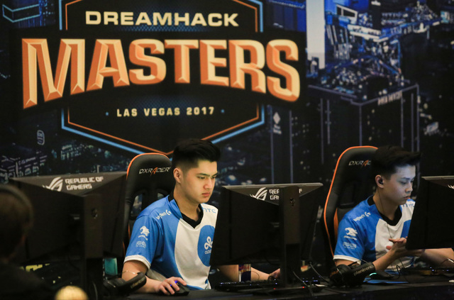 "Timothy ""autimatic"" Ta, left and Jake ""Stewie2k"" Yip of Cloud9 get ready to play Ninjas in Pyjamas during the group stage of DreamHack Masters Las Vegas at the MGM Grand hotel-casino in Las Vegas  ..."