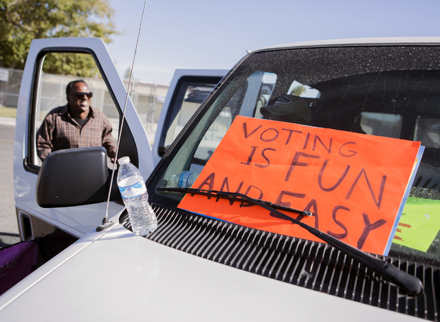 Volunteer Stanley Williams stands near a van near the Mabel Hoogard voting station on Tuesday, Nov. 8, 2016, 2016. For over 60 years volunteers in the West Las Vegas neighborhood have been driving ...