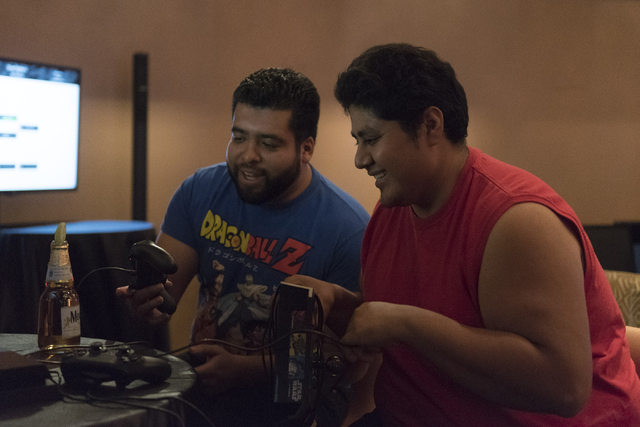 Felipe Sarmiento, left, and Angel Trejo compete in the Street Fighter V tournament at the Downtown Underground e-sports lounge at Downtown Grand in Las Vegas, June 3, 2016. (Jason Ogulnik/Las Vega ...