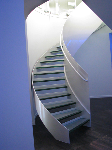 The central spiral staircase in the high-end rental home at the end of Probst Way on the foothills of Frenchman Mountain is made of one inch thick steel. It is one piece of metal and had to be sen ...
