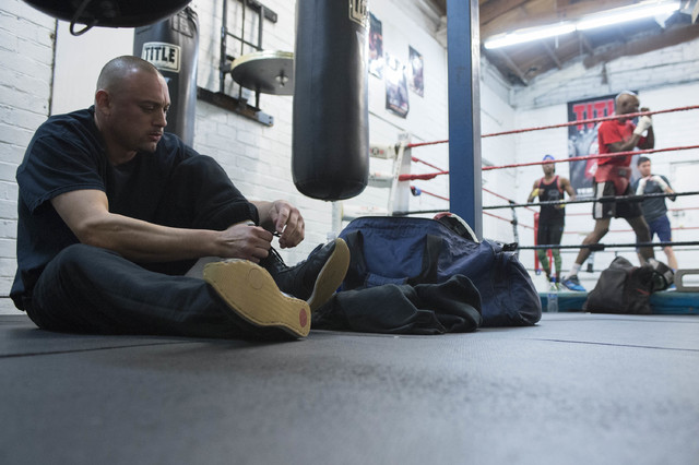 Mark Martinez laces up at while other boxers warm up in th background at Johnny Tocco's Ringside Gym in Las Vegas on Friday, Feb. 3, 2017. Martinez has been coming to  Johnny Tocco's Ringside Gym  ...