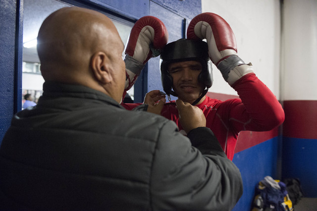 Rahim Gonzales puts on his head guard prior to a fight at Johnny Tocco's Ringside Gym in Las Vegas on Friday, Feb. 3, 2017. (Bridget Bennett/Las Vegas Review-Journal) @bridgetkb