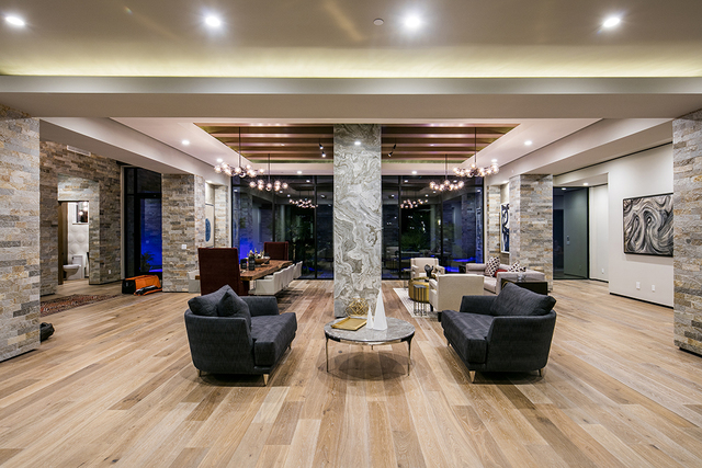 The home features Siberian oak-plank floors and stacked stones. (Courtesy)