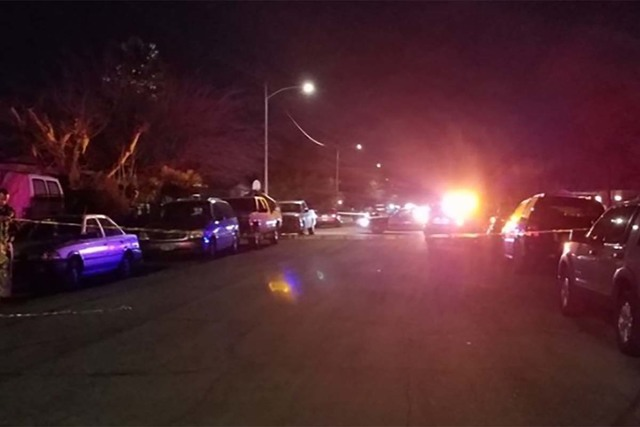 Las Vegas police investigate a shooting late Monday night outside a home near West Washington Avenue and North Jones Boulevard. (Mike Shoro/Las Vegas Review-Journal)