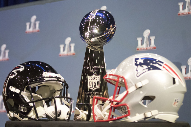 The Lombardi trophy remains on display during a press conference from NFL commissioner Roger Goodell ahead of Super Bowl 51 on Feb. 1, 2017 in Houston, Texas, at the George R. Brown Convention Cen ...