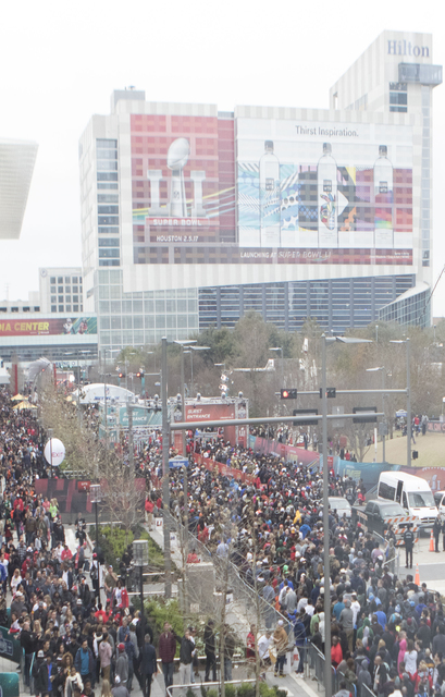 An overview of the lines for the NFL experience (left) and Super Bowl Live fan zone in Houston, Texas, on Avenida De Las Americas on Saturday ahead of Super Bowl 51. (Heidi Fang/Las Vegas Review-J ...