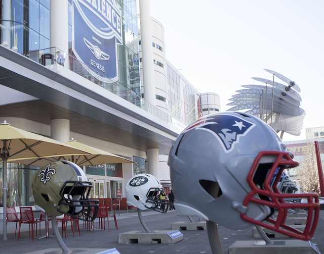 The New England Patriots helmet (right) is displayed in front of the George R. Brown Convention Center on Jan. 30, 2017, on Avenida De Las Americas in Houston, Texas. (Heidi Fang/Las Vegas Review- ...
