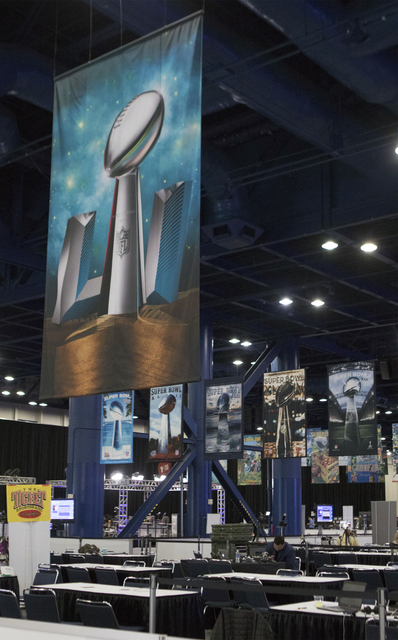 Super Bowl LI signage hangs over radio row inside the George R. Brown Convention Center in Houston, Texas, on Jan. 30, 2017. (Heidi Fang/Las Vegas Review-Journal) @HeidiFang