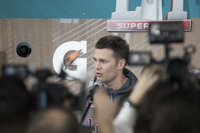 New England Patriots quarterback Tom Brady answers questions from media at Minute Maid Park in Houston, Texas, at Super Bowl LI Opening Night on Jan. 30, 2017. (Heidi Fang/Las Vegas Review-Journal ...