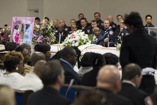 Mourners including members of the Las Vegas Fire Department attend the funeral service for Diana Bankston and her 8-year-old daughter Kaysha Ray, at True Love Missionary Baptist Church, Saturday,  ...