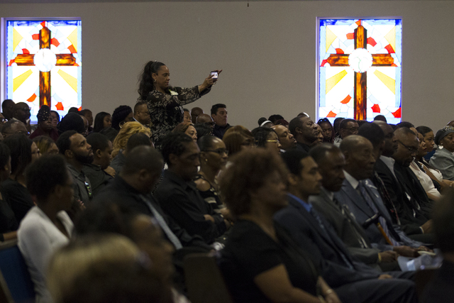 Mourners attend the funeral service for Diana Bankston and her 8-year-old daughter Kaysha Ray, at True Love Missionary Baptist Church on Saturday, Feb. 4, 2017, in Las Vegas. Bankston and her daug ...