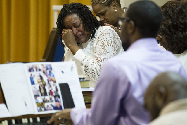 Laura Manson wipes her eyes after singing during the funeral service for Diana Bankston and her 8-year-old daughter Kaysha Ray, at True Love Missionary Baptist Church, Saturday, Feb. 4, 2017, in L ...