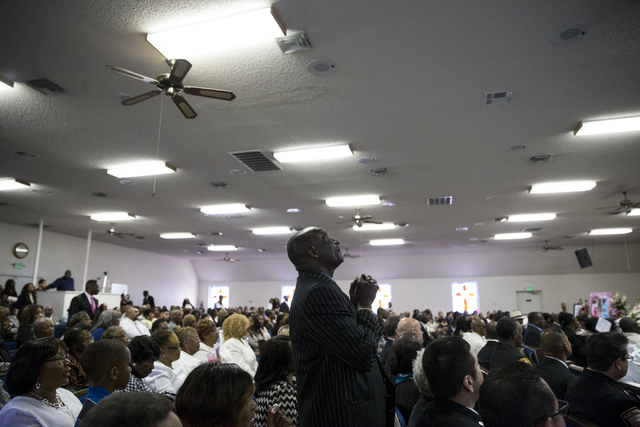 Mourners attend the funeral service for Diana Bankston and her 8-year-old daughter Kaysha Ray, at True Love Missionary Baptist Church, Saturday, Feb. 4, 2017, in Las Vegas. Bankston and her daught ...