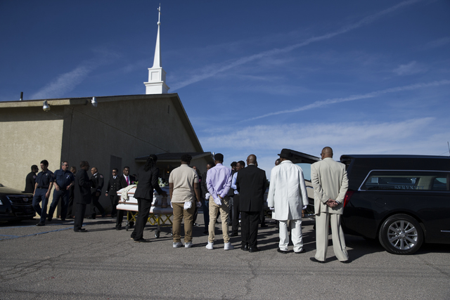 The caskets with the remains of Diana Bankston and her 8-year-old daughter Kaysha Ray are moved to a hearse following a funeral service at True Love Missionary Baptist Church, Saturday, Feb. 4, 20 ...