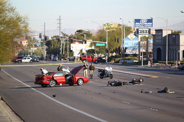 Las Vegas police respond to the scene of a crash involving two motorcycles and one car on Flamingo Road near Maryland Parkway in Las Vegas on Jan. 19, 2015. (Chase Stevens/Las Vegas Review-Journal)
