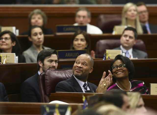 Nevada Senate Majority Leader Aaron Ford claps with wife Berna Rhodes-Ford during the State of the State address at the Legislative Building in Carson City on Tuesday, Jan. 17, 2017. (Chase Steven ...