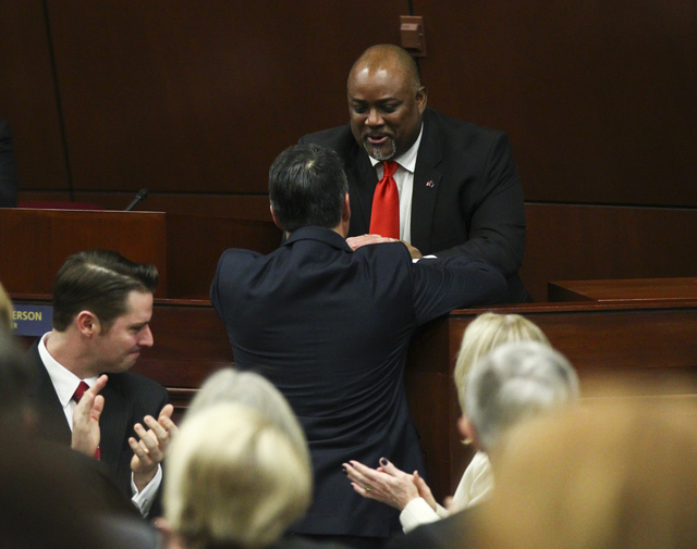 Assembly Speaker Jason Frierson greets Nevada Gov. Brian Sandoval before the State of the State address at the Legislative Building in Carson City on Tuesday, Jan. 17, 2017. (Chase Stevens/Las Veg ...