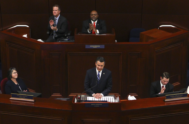 Assembly Speaker Jason Frierson, above center, claps as Nevada Gov. Brian Sandoval gives his final State of the State address at the Legislative Building in Carson City on Tuesday, Jan. 17, 2017.  ...