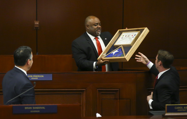 Assembly Speaker Jason Frierson holds an honor flag during ceremonial proceedings before Nevada Gov. Brian Sandoval's State of the State address at the Legislative Building in Carson City on Tuesd ...