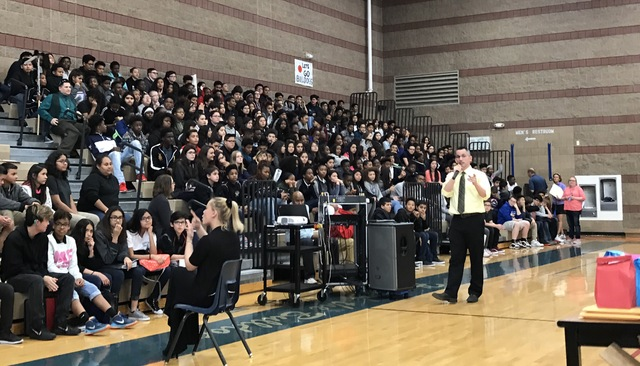 Eight grade students of Johnston Middle School listen to their principal, Demetrius Johnson, speak Feb. 15, 2017 inside the school's gym in North Las Vegas. (Raven Jackson/View) @ravenmjackson
