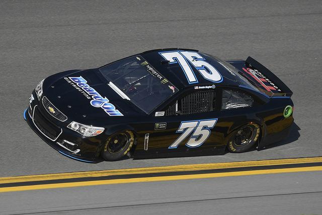 Brendan Gaughan (75) drives through Turn 4 during a qualifying run for the NASCAR Daytona 500 auto race at Daytona International Speedway in Daytona Beach, Fla., Sunday, Feb. 19, 2017. (AP Photo/P ...