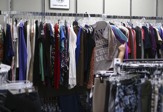 A student looks through shirts inside Betty's Boutique, run by Project 150, in Las Vegas on Thursday, Feb. 2, 2017. Project 150 provides local high school students in need with clothes, food and s ...