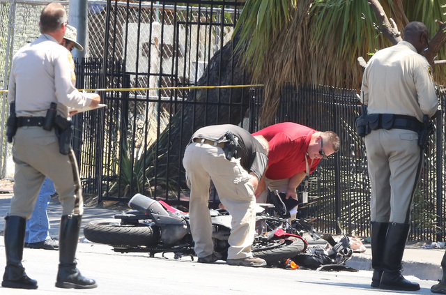 Las Vegas police investigate a crash involving a motorcycle near Twain Avenue and Swenson Street on July 19, 2016. A motorcyclist was taken to the hospital with potentially life-threatening injuri ...