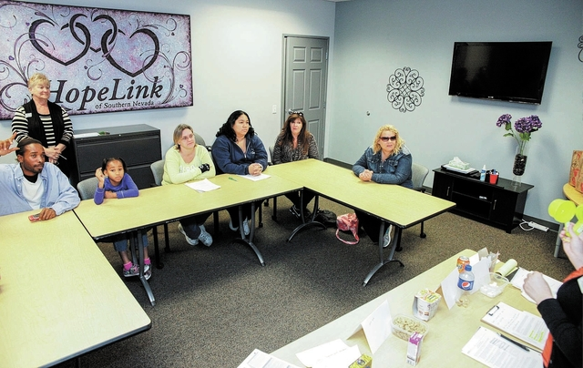 Participants answer questions during a demonstration on expected serving sizes and calorie count of a variety of foods at HopeLink, 178 Westminster Way in Henderson Monday, Nov. 11, 2013. (Robert  ...