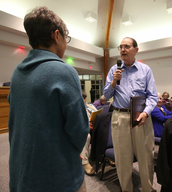 Frank Emma, representing Saint Andrews Catholic Church, speaks to the crowd as Pat Benke, of Boulder City United Methodist Church, looks on at a meeting organized by Nevadans for the Common Good t ...