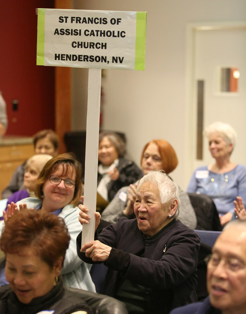 Jan Merino, representing St. Francis of Assisi Catholic Church in Henderson, cheers during a meeting organized by Nevadans for the Common Good to address the funding needed to support Meals on Whe ...