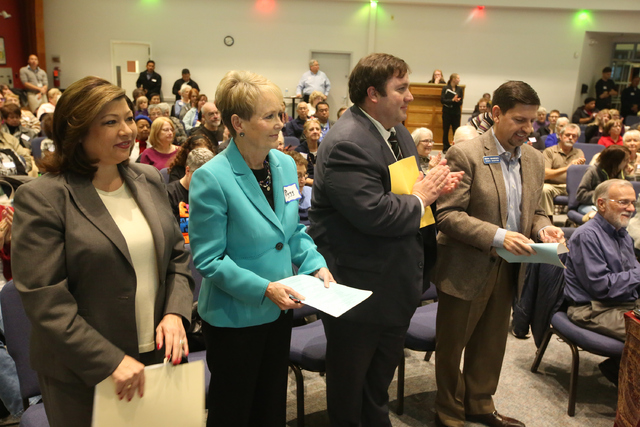 Henderson City Councilwoman Gerri Schroder, far left, Boulder City Councilwoman Peggy Leavitt, Assemblyman James Ohrenschall, D-Las Vegas, and State Senator Mark Manendo, D-Las Vegas, stand for a  ...