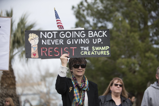 A woman who declined to give her name participates during a rally with other health care advocates protesting changes to the Affordable Care Act at Heritage Park on Saturday, Feb. 25, 2017, in Las ...