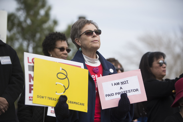 Jeannine Spicer participates during a rally with other health care advocates protesting changes to the Affordable Care Act at Heritage Park on Saturday, Feb. 25, 2017, in Las Vegas. (Erik Verduzco ...
