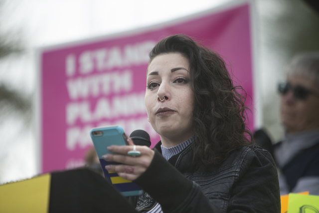 ShaeAnn Clements shares her story of her medical condition to other health care advocates protesting changes to the Affordable Care Act during a rally at Heritage Park on Saturday, Feb. 25, 2017,  ...